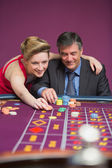 Woman placing bet for man — Stock Photo