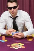 Man in sunglasses playing poker — Stock Photo