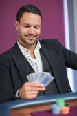 Man holding cards smiling — Stock Photo