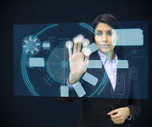 Concentrate woman standing while touching interface — Stock Photo