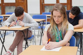 Female student sitting at table — Stock Photo