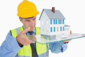 Architect looking at hologram house — Stock Photo