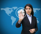 Businesswoman touching holographic screen against blue backgroun — Stock Photo