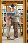 Couple standing at the library — Stock Photo