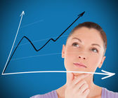 Woman looking at a chart — Stock Photo