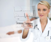 Doctor using ECG interface — Stock Photo