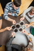 Holding up cups of coffee — Stock Photo