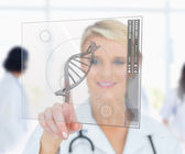 Woman pressing on DNA helix interface — Stock Photo