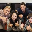 Students giving thumbs up — Stock Photo #23100052
