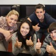 Students giving thumbs up — Stock Photo