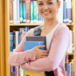 Student standing at the library — Stock Photo