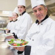 Smiling Chef's presenting their salads — Stock Photo