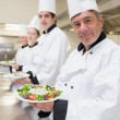Stock Photo: Smiling Chef's presenting their salads