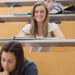 Student sitting at the lecture hall while smiling — Stock Photo