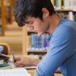 Student studying in library — Stock Photo #23100846