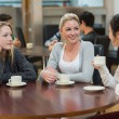 Students talking together in coffee shop — Stock Photo