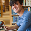 Student sitting at the library — Stock Photo