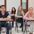 Students sitting at the classroom listening — Stock Photo
