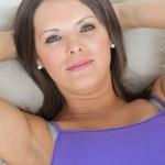 Woman lying on the sofa — Stock Photo #23101626