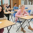 Stock Photo: Students sitting at classroom