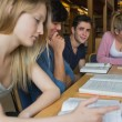 Students in the library in a study group — Stock Photo