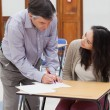 Teacher helping student with work — Stock Photo #23101900