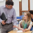 Stock Photo: Teacher is reassuring student