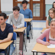 Students sitting in the exam room — Stock Photo #23102004