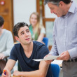 Teacher talking to student — Stock Photo #23102222