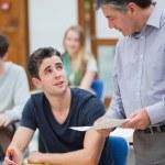 Teacher talking to student — Stock Photo #23102222