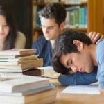Student sleeping at study table — Stock Photo