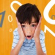 Stock Photo: Boy looking scared against orange background
