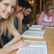 Stockfoto: Smiling student with study group