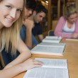 Stock Photo: Smiling student with study group