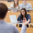 Students sitting at the lecture hall listening — Stock Photo #23102582