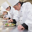 Stock Photo: Chef's preparing their salads