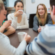 Students sitting at the table drinking coffee — Stock Photo