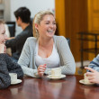 Sitting at the coffee shop smiling — Stock Photo
