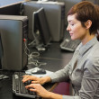Woman sitting at the computer at the computer room — Stock Photo