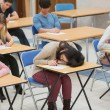 Girl sleeping during exam — Stock Photo