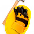 Two leather gloves in a helmet with a hammer - Stock Photo