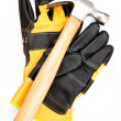 Hammer with pair of protective gloves - Stock Photo