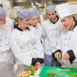 Trainees learning vegetable slicing — Stock Photo