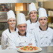 Stock Photo: Happy group of Chef's