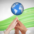 Reaching hands to globe — Stock Photo
