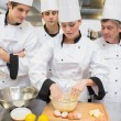 Stock Photo: Culinary students learning how to mix dough