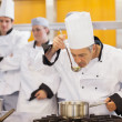 Chef tasting his students work - Foto Stock