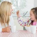 Girl feeding her mother — Stock Photo