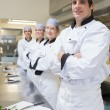 Team of Chef's standing in the kitchen — Stock Photo #23106302