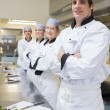 Team of Chef's standing in the kitchen — Stock Photo